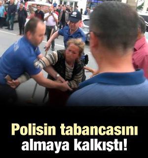 Polisin tabancasını almaya kalkıştı!